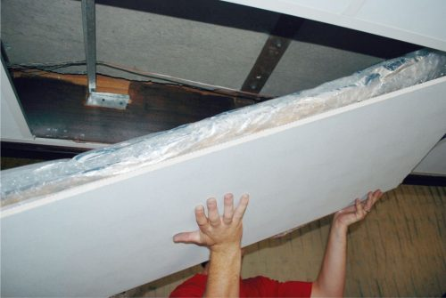 Installation of insulation on top of self adhesive ceililng heating pad